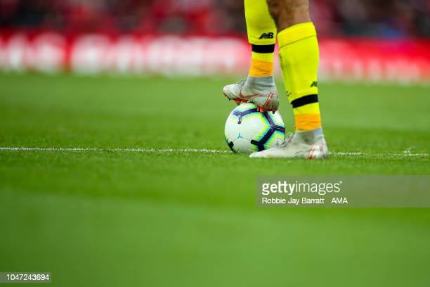 Alisson Becker of Liverpool stands on the Premier League Nike Merlin match ball in Nike Mercurial football boots during the Premier League match...