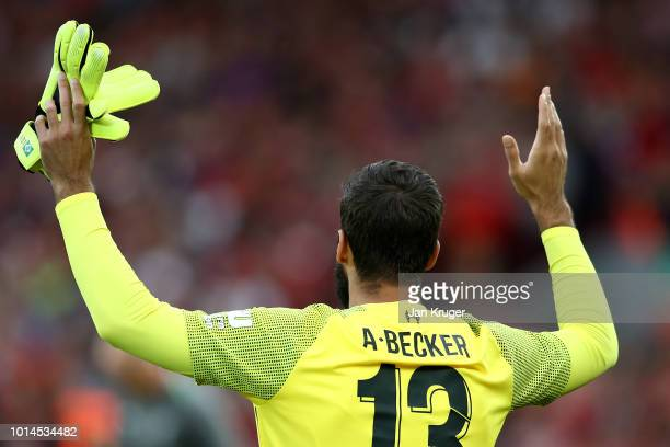Alisson Becker of Liverpool walks out during the friendly match between Liverpool and Torino at Anfield on August 7 2018 in Liverpool England