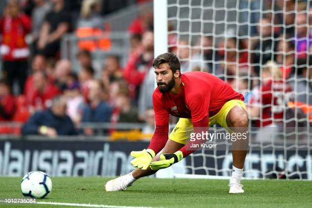 Alisson Becker of Liverpool warms up during the preseason friendly match between Liverpool and Torino at Anfield on August 7 2018 in Liverpool England