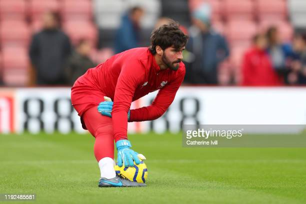 Alisson Becker of Liverpool warms up prior to the Premier League match between AFC Bournemouth and Liverpool FC at Vitality Stadium on December 07...