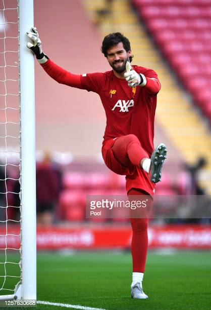 Alisson Becker of Liverpool warms up prior to the Premier League match between Liverpool FC and Chelsea FC at Anfield on July 22 2020 in Liverpool...