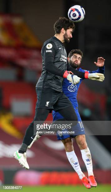Alisson Becker of Liverpool wins a header with Christian Pulisic of Chelsea during the Premier League match between Liverpool and Chelsea at Anfield...
