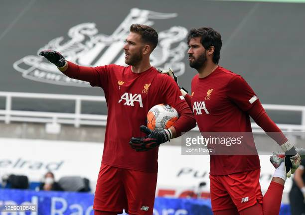 Alisson Becker of Liverpool with Adrian before the Premier League match between Newcastle United and Liverpool FC at St James Park on July 26 2020 in...