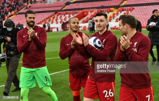 Alisson Becker of Liverpool with Thiago Alcantara of Liverpool and Andy Robertson of Liverpool with James Milner of Liverpool at the end of the...
