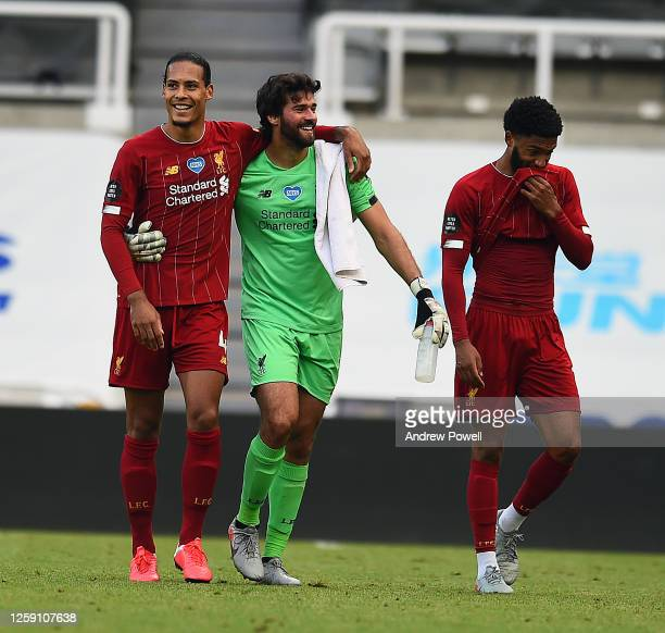 Alisson Becker of Liverpool with Virgil van Dijk of Liverpool and Joe Gomez of Liverpool at the End of the Premier League match between Newcastle...