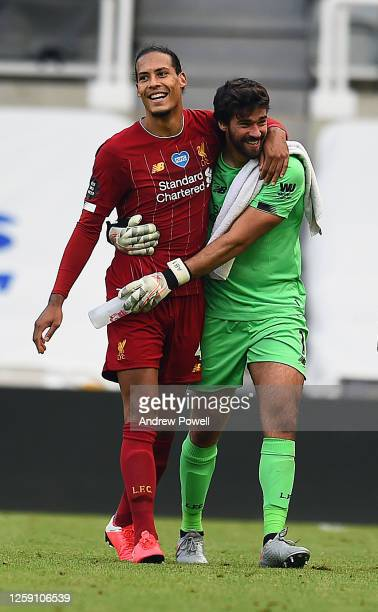 Alisson Becker of Liverpool with Virgil van Dijk of Liverpool at the End of the Premier League match between Newcastle United and Liverpool FC at St...