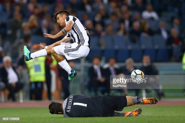 Alisson Becker of Roma saving on Paulo Dybala of Juventus during the Italian Serie A football match AS Roma vs Juventus at the Olympic stadium on May...