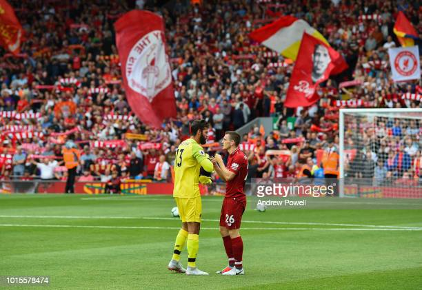 Alisson Becker with Andy Robertson of Liverpool before the Premier League match between Liverpool FC and West Ham United at Anfield on August 12 2018...