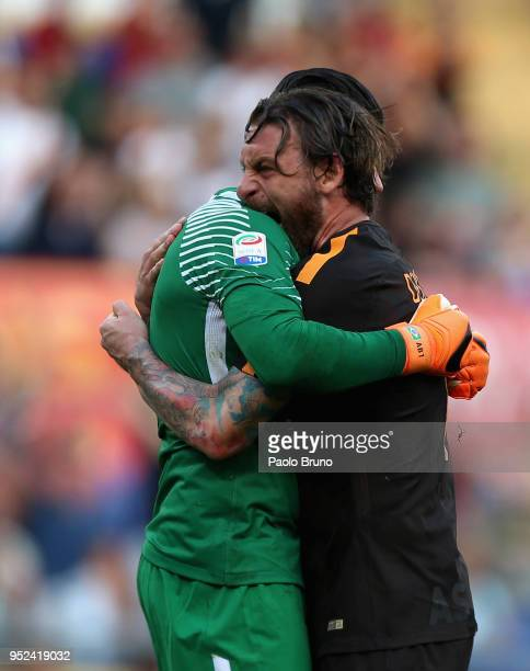 Alisson Becker with his teammate Daniele De Rossi of AS Roma reacts after saving the penalty during the serie A match between AS Roma and AC Chievo...