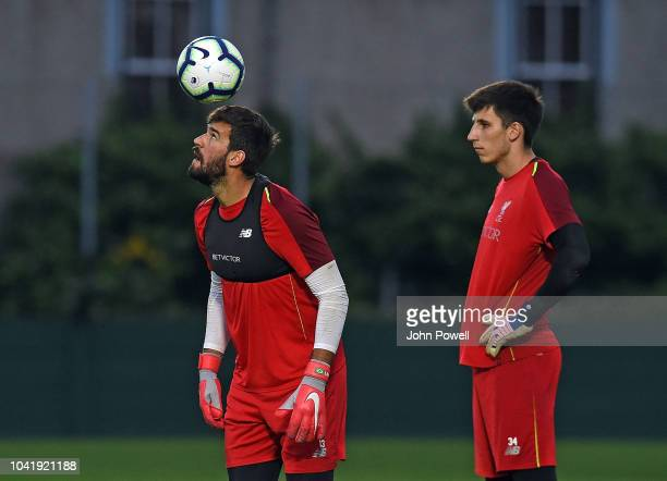 Alisson Becker with Kamil Grabara of Liverpool during a training session at Melwood Training Ground on September 27 2018 in Liverpool England
