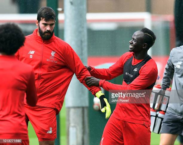 Alisson Becker with Sadio Mane of Liverpool during a training session at Melwood Training Ground on August 8 2018 in Liverpool England