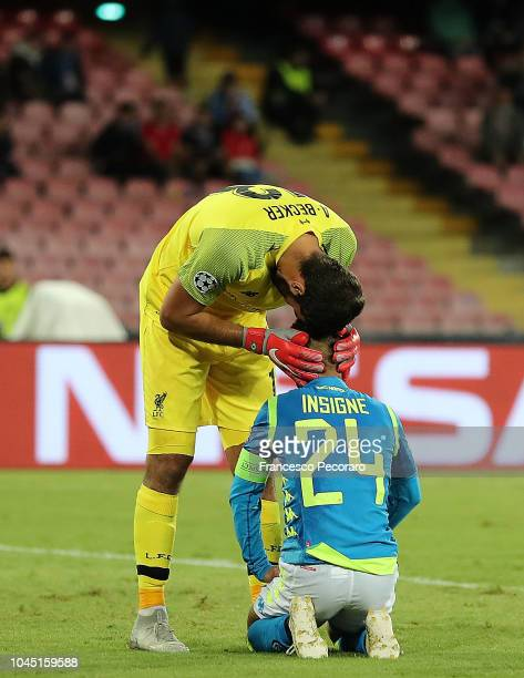 Alisson comfort Lorenzo Insigne during the Group C match of the UEFA Champions League between SSC Napoli and Liverpool at Stadio San Paolo on October...