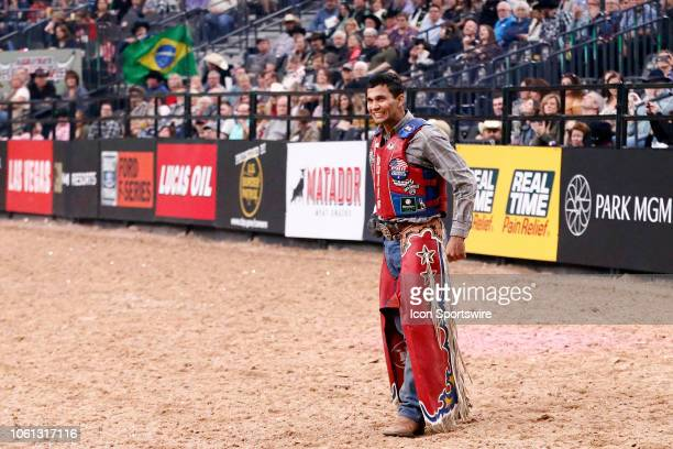 Alisson De Souza celebrates following his ride of bull Short Pop during the final round of the Professional Bull Riders World Finals on November 11...