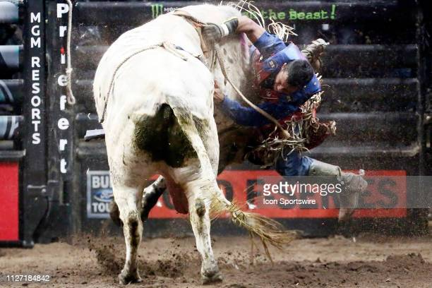 Alisson De Souza gets bucked from bull Smooth Operator during the Professional Bull Riders Iron Cowboy presented by Ariat on February 23 at the...