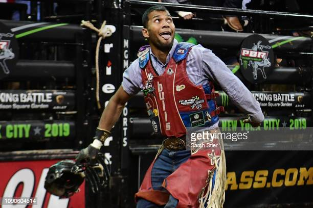 Alisson De Souza reacts after his ride on Short Pop during the PBR Unleash the Beast bull riding event at Madison Square Garden on January 06 2019 in...