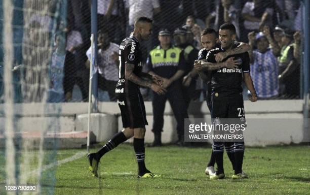 Alisson Euler de Freitas Castro of Brazilian Gremio celebrates with teammates after scoring a goal against Argentinian Atletico Tucuman during their...