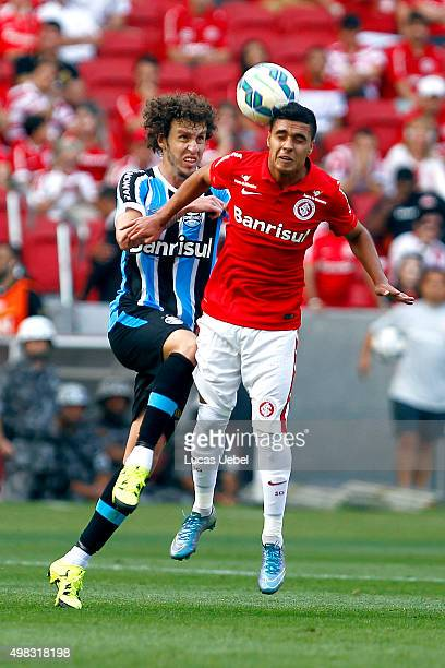 Alisson Farias of Internacional battles for the ball against Rafael Galhardo of Gremio during the match between Internacional and Gremio as part of...