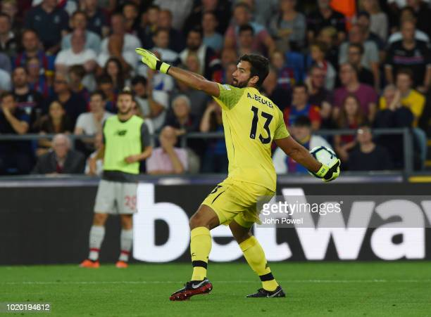 Alisson goalkeeper of Liverpool throws the ball during the Premier League match between Crystal Palace and Liverpool FC at Selhurst Park on August 20...