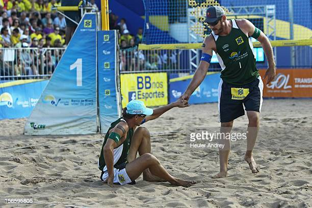 Alisson helps Emanuel during a match for the 5th stage of the season 2012/2013 of Banco do Brasil Beach Volleyball Circuit on November 17 2012 in...