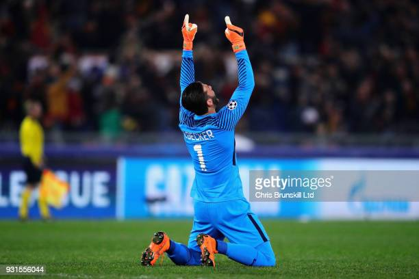 Alisson of AS Roma celebrates after his side scored the opening goal during the UEFA Champions League Round of 16 Second Leg match between AS Roma...