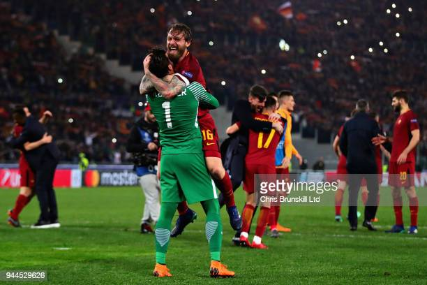 Alisson of AS Roma celebrates victory with teammate Daniele De Rossi after the UEFA Champions League Quarter Final second leg match between AS Roma...