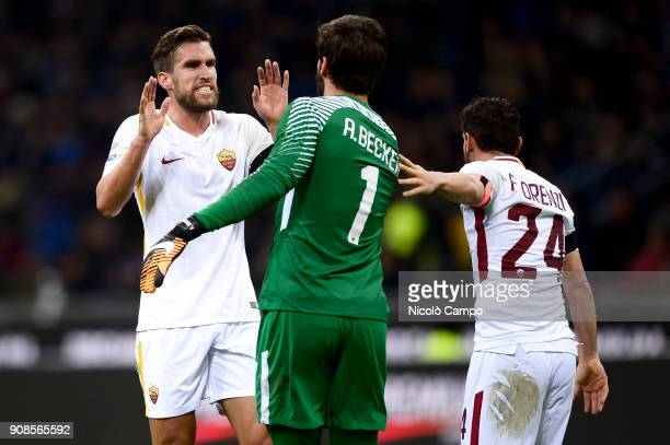 Alisson of AS Roma celebrates with Kevin Strootman and Alessandro Florenzi after making an assist during the Serie A football match between FC...