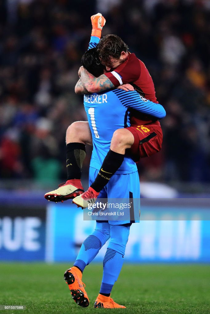 Alisson of AS Roma celebrates with teammate Daniele De Rossi after his side scored the opening goal during the UEFA Champions League Round of 16 Second Leg match between AS Roma and Shakhtar Donetsk at Stadio Olimpico on March 13, 2018 in Rome, Italy.