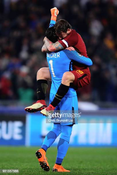 Alisson of AS Roma celebrates with teammate Daniele De Rossi after his side scored the opening goal during the UEFA Champions League Round of 16...