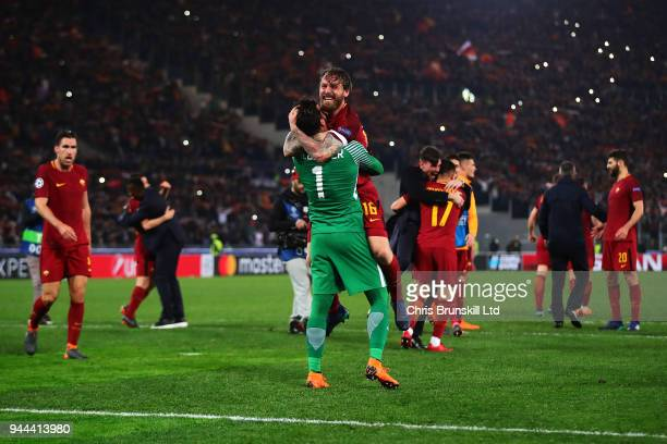 Alisson of AS Roma celebrates with teammate Daniele De Rossi following the UEFA Champions League Quarter Final second leg match between AS Roma and...