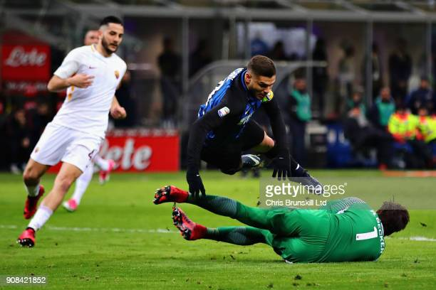 Alisson of AS Roma challenges Mauro Icardi of FC Internazionale for the ball during the Serie A match between FC Internazionale and AS Roma at Stadio...