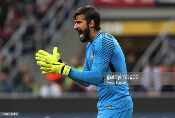 Alisson of AS Roma shouts to his teammates during the Serie A match between AC Milan and AS Roma at Stadio Giuseppe Meazza on October 1 2017 in Milan...