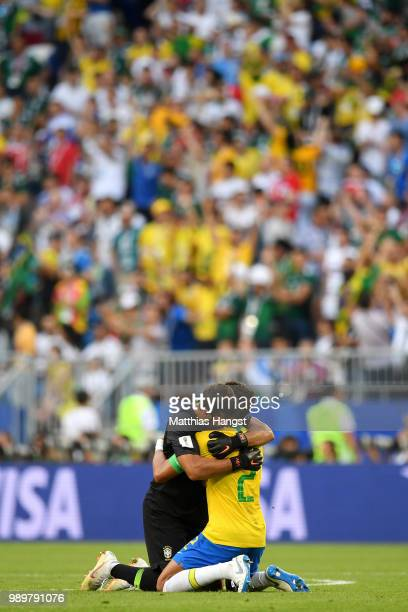 Alisson of Brazil and Thiago Silva of Brazil celebrate after teammate Roberto Firmino scores their sides second goal during the 2018 FIFA World Cup...