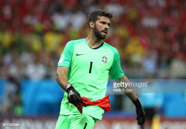 Alisson of Brazil bursts an inflatable ball during the 2018 FIFA World Cup Russia group E match between Brazil and Switzerland at Rostov Arena on...