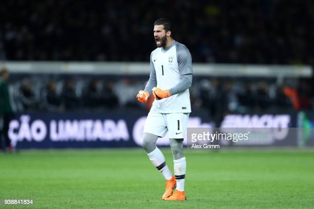 Alisson of Brazil celebrates his sides first goal during the International friendly between Germany and Brazil at Olympiastadion on March 27 2018 in...