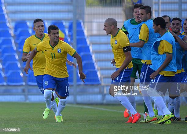 Alisson of Brazil celebrates scoring their first goal during the Final of the Toulon Tournament between France and Brazil at the Parc des Sports...