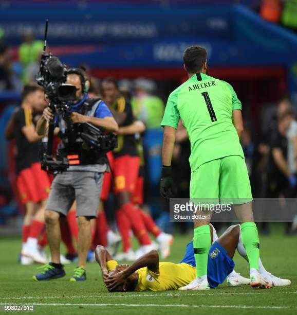Alisson of Brazil consoles team mate Fernandinho during the 2018 FIFA World Cup Russia Quarter Final match between Brazil and Belgium at Kazan Arena...