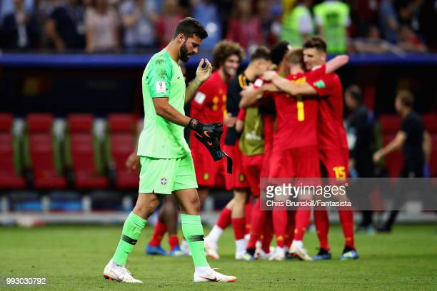 Alisson of Brazil looks dejected as the Belgium team celebrate after the 2018 FIFA World Cup Russia Quarter Final match between Brazil and Belgium at...