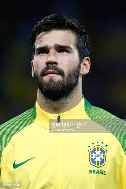 Alisson of Brazil looks on before a match between Brazil and Paraguay as part of 2018 FIFA World Cup Russia Qualifier at Arena Corinthians on March...