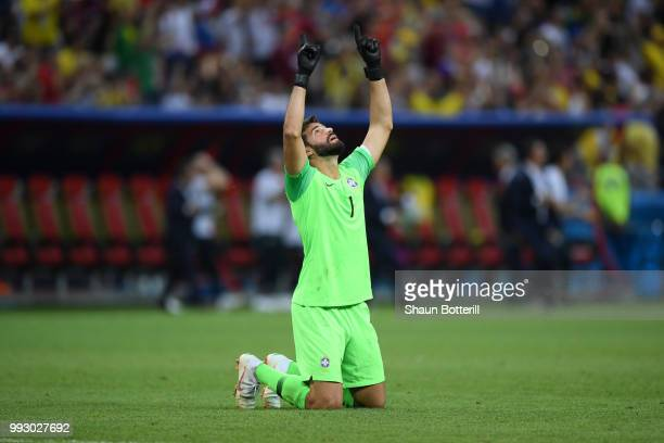 Alisson of Brazil prays following his sides defeat in the 2018 FIFA World Cup Russia Quarter Final match between Brazil and Belgium at Kazan Arena on...