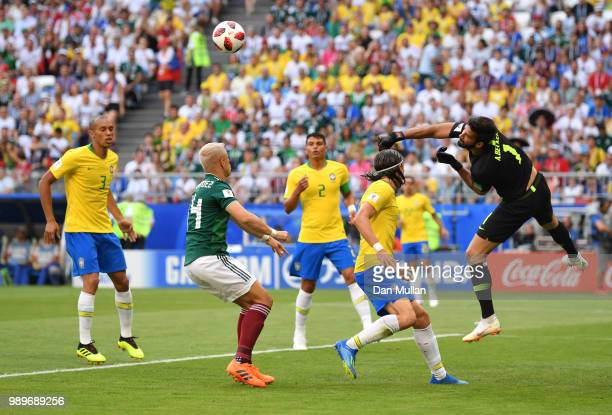 Alisson of Brazil punches the ball clear during the 2018 FIFA World Cup Russia Round of 16 match between Brazil and Mexico at Samara Arena on July 2...