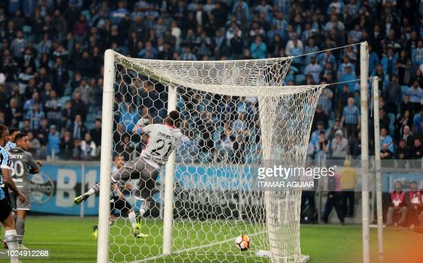 Alisson of Brazil's Gremio celebrates after scoring against Argentina's Estudiantes during their Copa Libertadores 2018 football match held at the...