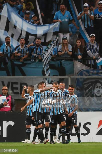 Alisson of Brazil's Gremio celebrates after scoring against Argentina's Atletico Tucuman during their Copa Libertadores 2018 football match held at...