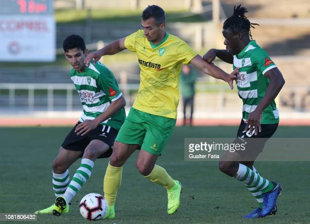 Alisson of CD Mafra with Gaius Makouta of SC Covilha and Diego Luiz of SC Covilha in action during the Portuguese Segunda Liga match between CD Mafra...