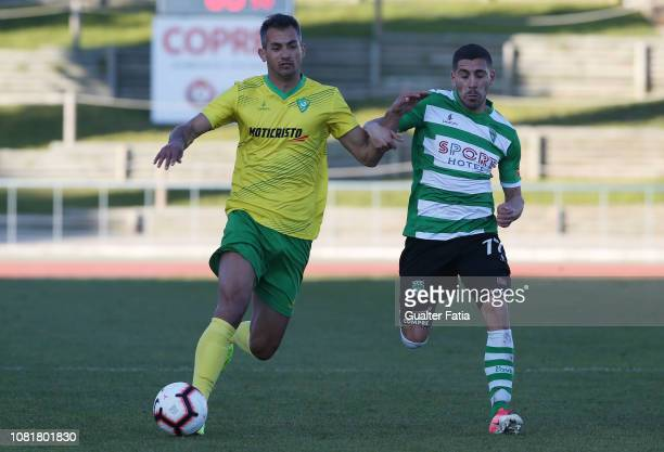Alisson of CD Mafra with Mica Silva of SC Covilha in action during the Portuguese Segunda Liga match between CD Mafra and SC Covilha at Estadio do...