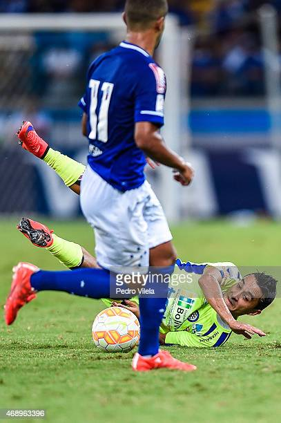 Alisson of Cruzeiro and Louis Pena of Mineros battle for the ball during a match between Cruzeiro and Mineros as part of Copa Bridgestone...