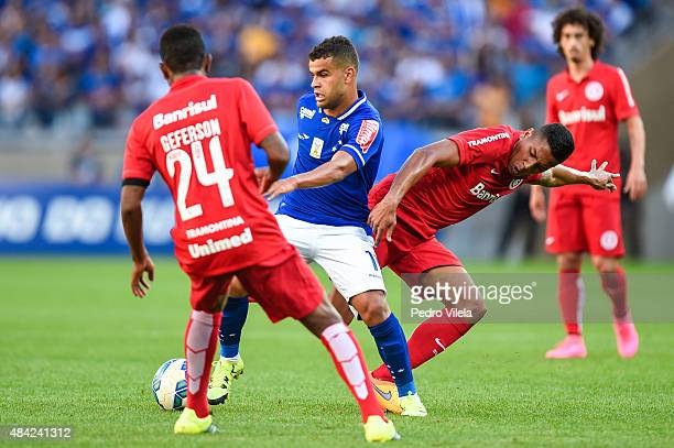 Alisson of Cruzeiro and Nicolas and Geferson of Internacional battle for the ball during a match between Cruzeiro and Internacional as part of...