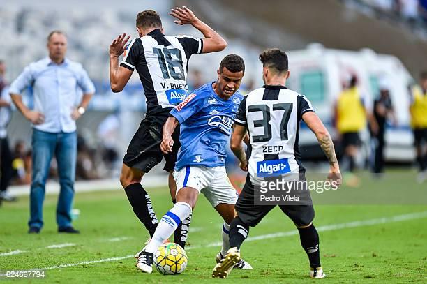 Alisson of Cruzeiro and Vitor Bueno and Zeca of Santos battle for the ball during a match between Cruzeiro and Santos as part of Brasileirao Series A...