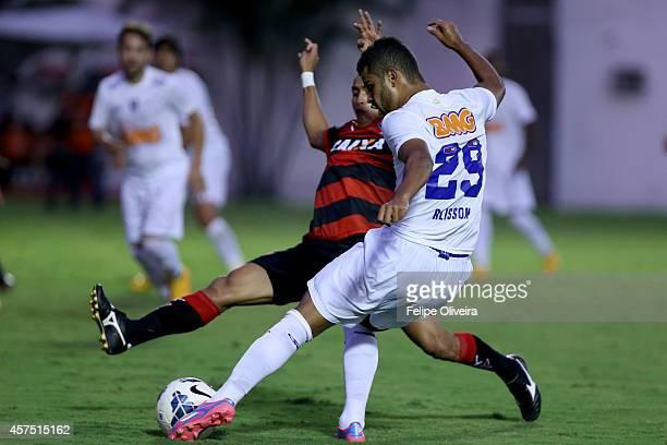 Alisson of Cruzeiro battles for the ball during the match between Vitoria and Cruzeiro as part of Brasileirao Series A 2014 at Estadio Manoel...