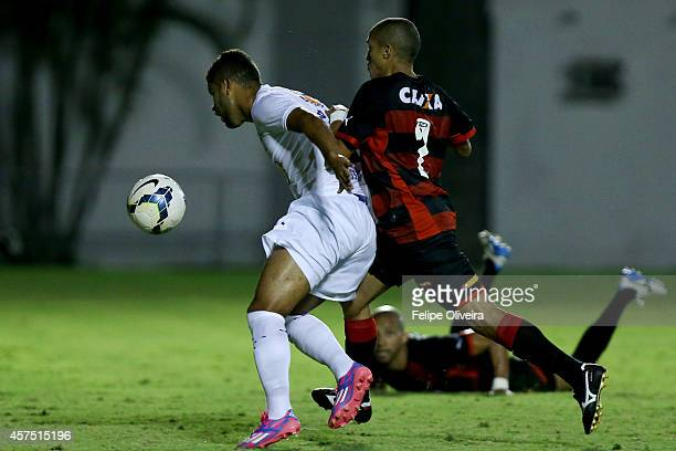 Alisson of Cruzeiro battles for the ball with Nino of Vitoriaduring the match between Vitoria and Cruzeiro as part of Brasileirao Series A 2014 at...