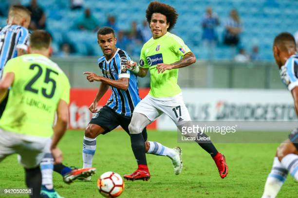 Alisson of Gremio battles for the ball against Carlos Surez of Monagas during the match between Gremio and Monagas part of Copa Libertadores 2018 at...